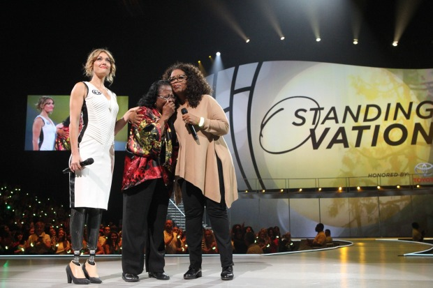 """Oprah Winfrey and Amy Purdy (far left) with Estella Pyfrom (middle), founder of Estella's Brilliant Bus, recipient of the Toyota """"Standing O-Vation"""" Award"""